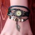 Dámské hodinky pírko
